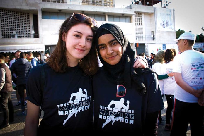 Two young women at the starting line of the Palestine Marathon 2017 in Bethlehem.