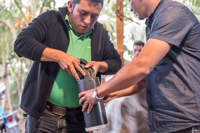 Wilfredo from CEPAD in Nicaragua, building a home0made water filter for the community of Teustepe.