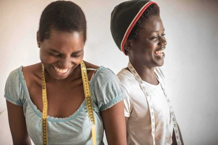 Two young women who have formed a sewing business in Tanzania thanks to Cheka Sana Foundation.