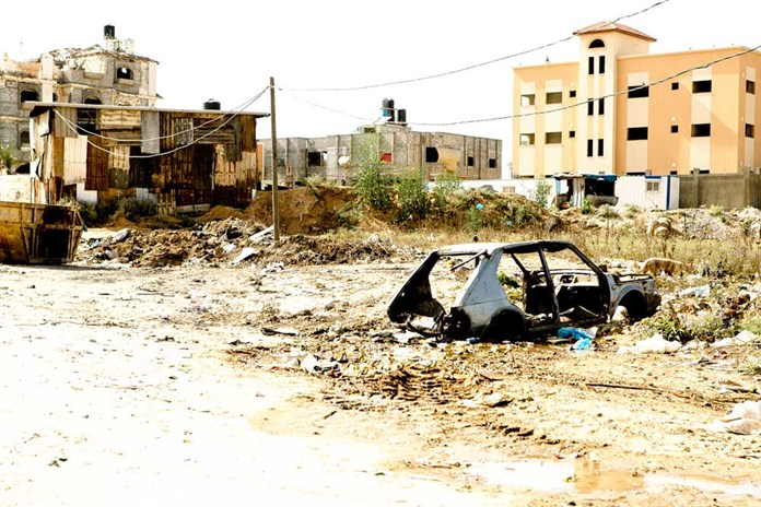 A bombed out car on the outskirts of Gaza City.