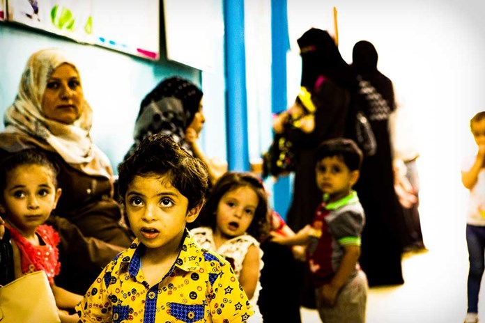 Toddlers waitng to see a doctor at a health centre in Gaza City.
