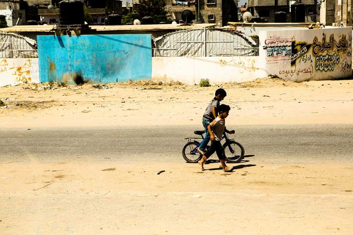 Two young boys playing in the street in Gaza City.
