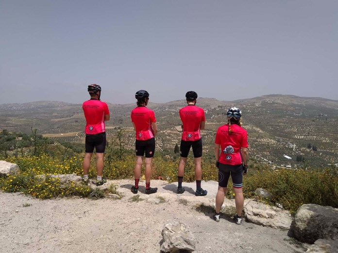 Four Amos Road Club members taking in the view across the West Bank.