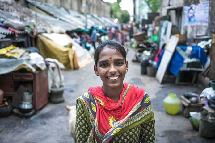 A young women smiles on the streets of Chennai, India