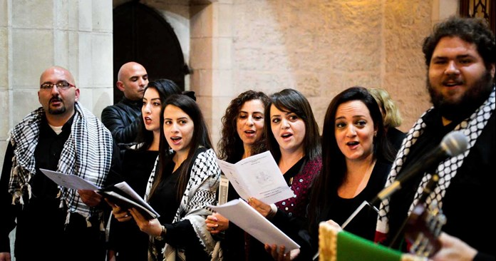 Choir of Bethlehem singing in St George's Cathedral in Jerusalem.