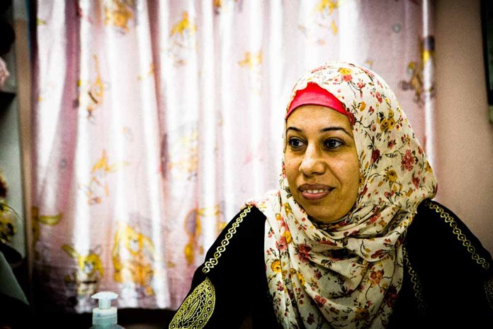 A woman from Gaza wearing a colourful head scarf.