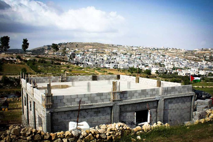 A half-built house on the outskirts of a refugee camp in Palestine.