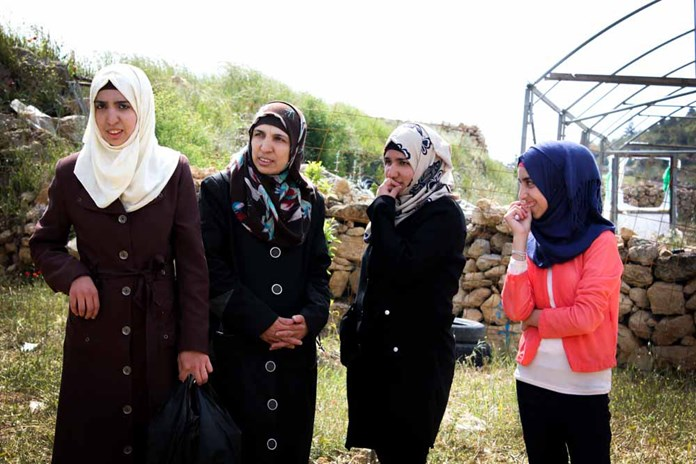 A family of women standing in their garden in Palestine.