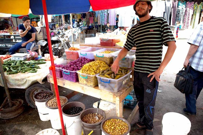 A young man on his market stall in down-town Gaza City.