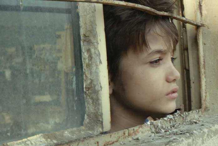 A young looking out of a window – a still from the film 'Capernaum'.