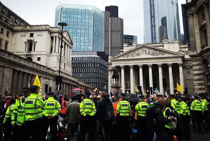 A Police cordon around Extinction Rebellion protestors outside the Bank of England in London.