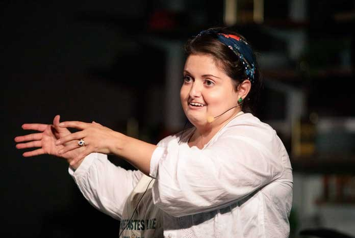 Palestinian chef Phoebe Rison cooking with Amos trust at Greenbelt Festival 2019.