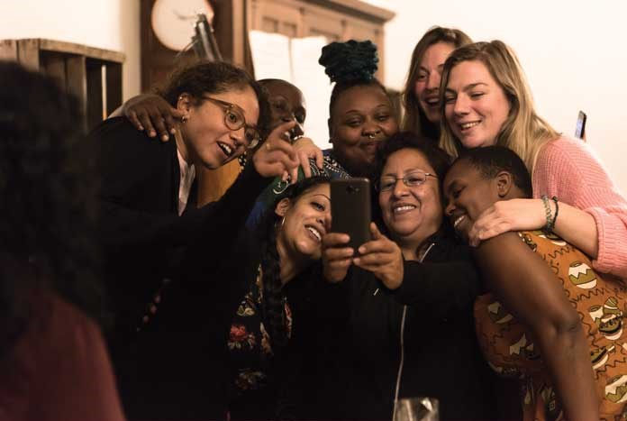 A group of international women taking a Selfie together.