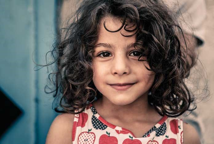 A young girl from a refugee camp in Bethlehem poses for the camera.