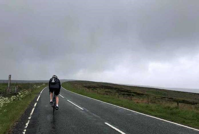 A loan Amos Road Club cyclist riding through the Peak District.