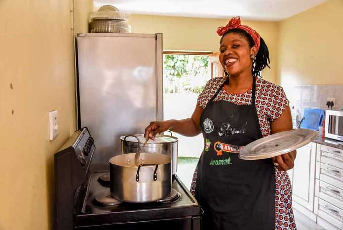 A women cooking for homeless young people at Umthombo in Durban, South Africa.
