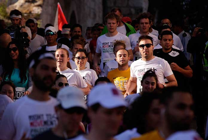 A group on people running the Palestine Marathon.